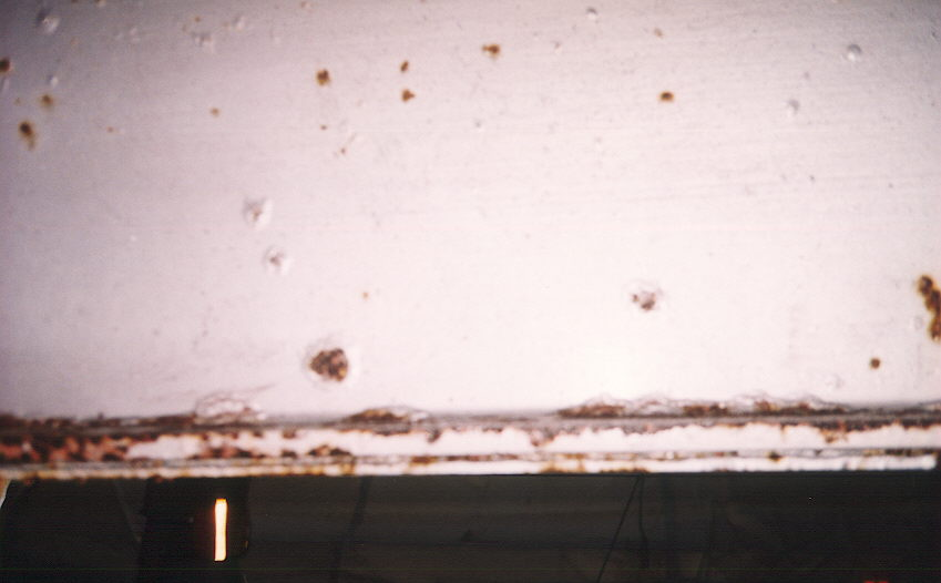 Blisters in paint under bridge before paint removal.jpg