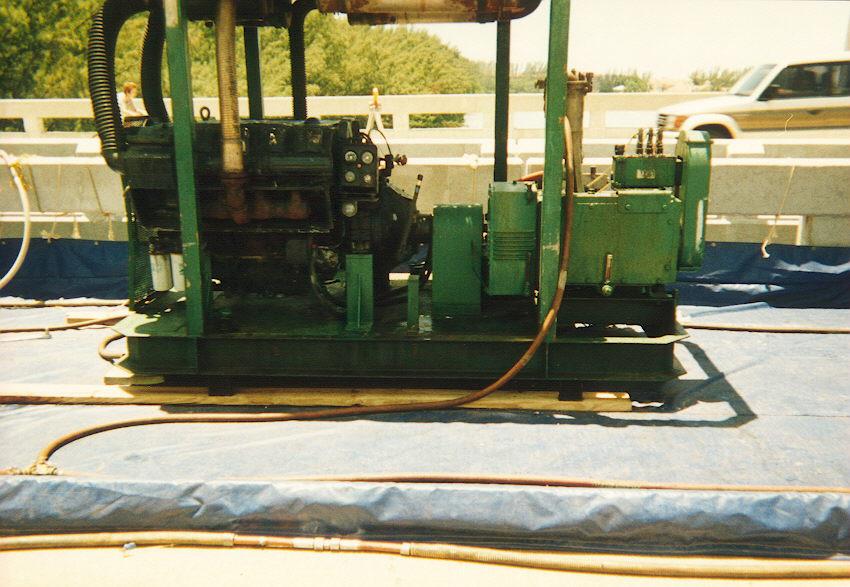 Water Jet pump used in paint removal on bridge.jpg