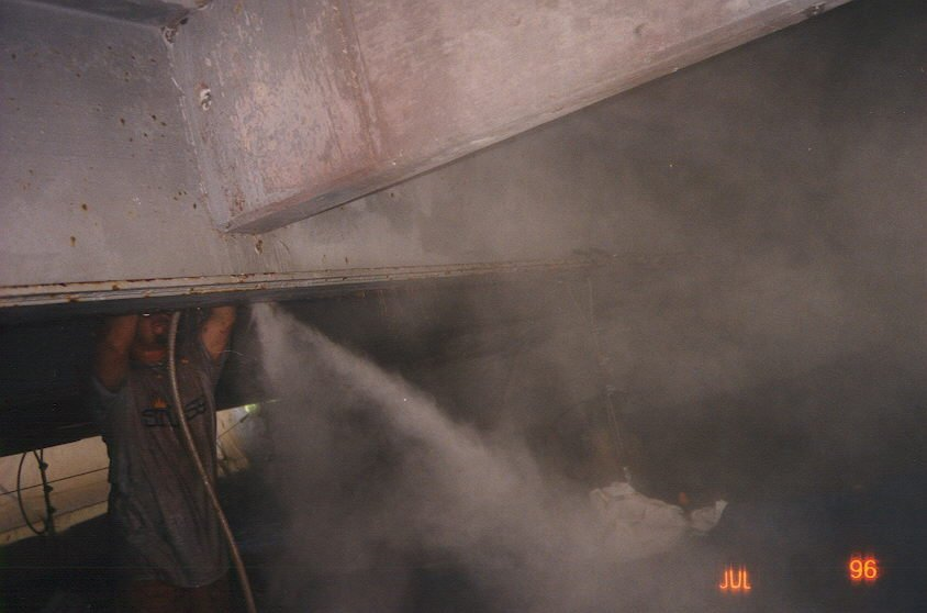 Water jets removing paint under bridge at Boca Raton.jpg